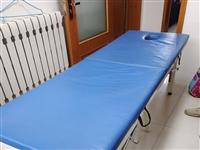 折疊**按摩床一張,規格1.8×60,鐵架實木,因店搬遷,割愛出售,有意詳詢13181501760