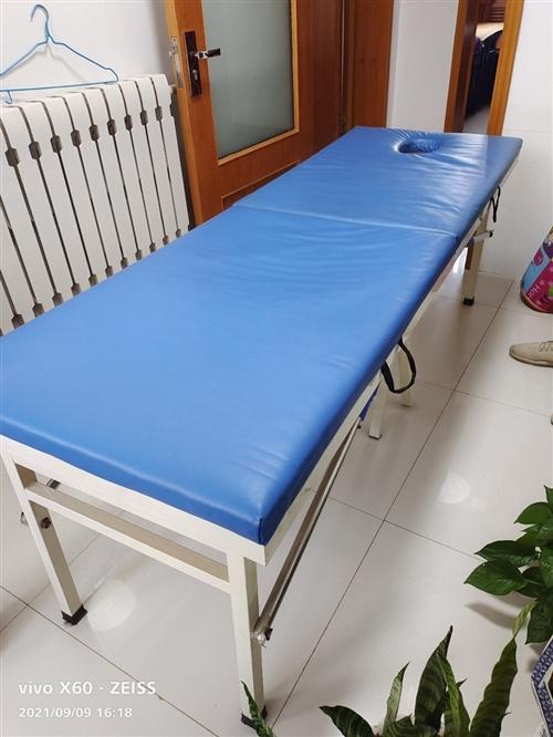 折叠**按摩床一张,规格1.8×60,铁架实木,因店搬迁,割爱出售,有意详询13181501760