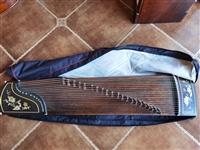 出售二手163古筝,报成人兴趣班时候买的,现闲置转让,送谱台,支架,背包